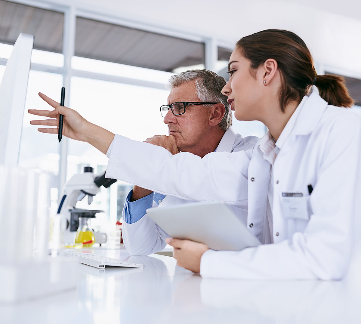 Shot of two scientists working together on a computer in a lab